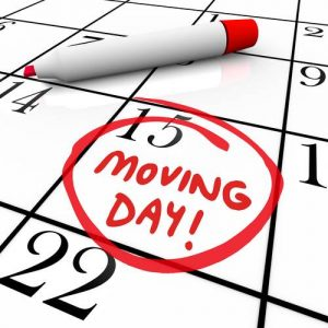 The words Moving Day and a date circled on a calendar with a red marker to illustrate a reminder of an important time for relocation to a new home or place of business